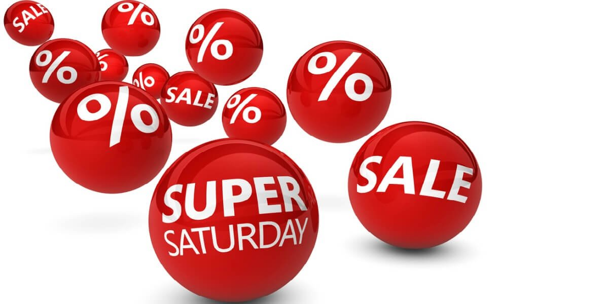 Super saturday shopping christmas sale and deals concept with sign and text on red bouncing spheres on white background.
